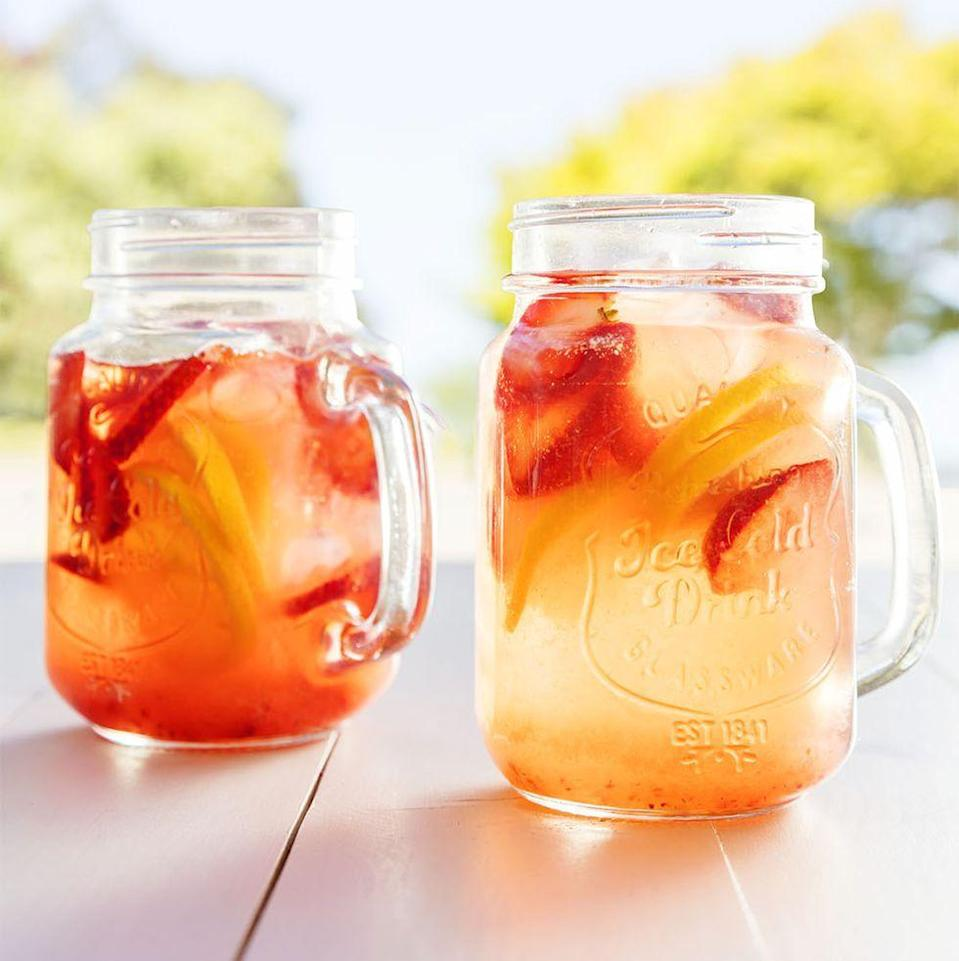 """<p>Homemade strawberry simple syrup takes this non-alcoholic drink to the next level.</p><p><em><a href=""""https://www.womansday.com/food-recipes/a36040162/fresh-berry-lemonade-recipe/"""" rel=""""nofollow noopener"""" target=""""_blank"""" data-ylk=""""slk:Get the recipe from Woman's Day »"""" class=""""link rapid-noclick-resp"""">Get the recipe from Woman's Day »</a></em></p>"""