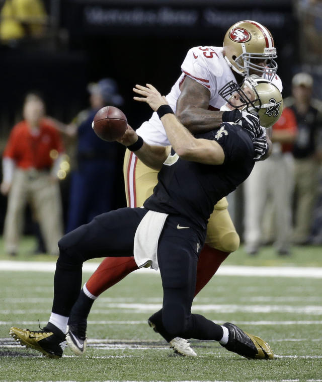 New Orleans Saints quarterback Drew Brees (9) is sacked by San Francisco 49ers outside linebacker Ahmad Brooks (55) in the second half of an NFL football game in New Orleans, Sunday, Nov. 17, 2013. (AP Photo/Dave Martin)