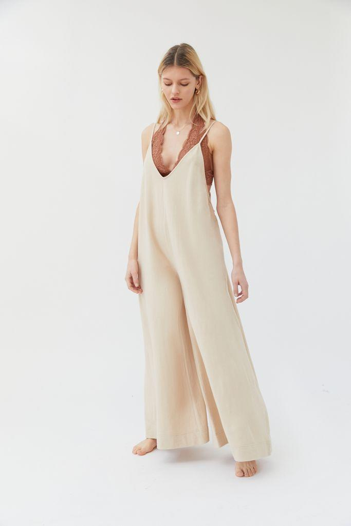 "Another slide, another oversized jumpsuit we're adding to cart. This one from Urban Outfitters features a fully loose fit throughout the entire body, including the billowy wide-legs. You can tie up the straps to adjust the length, but part of what makes piece so great is the option for a cute bra or crop top to peak out from underneath. $59, Urban Outfitters. <a href=""https://www.urbanoutfitters.com/shop/out-from-under-joey-wide-leg-jumpsuit"" rel=""nofollow noopener"" target=""_blank"" data-ylk=""slk:Get it now!"" class=""link rapid-noclick-resp"">Get it now!</a>"