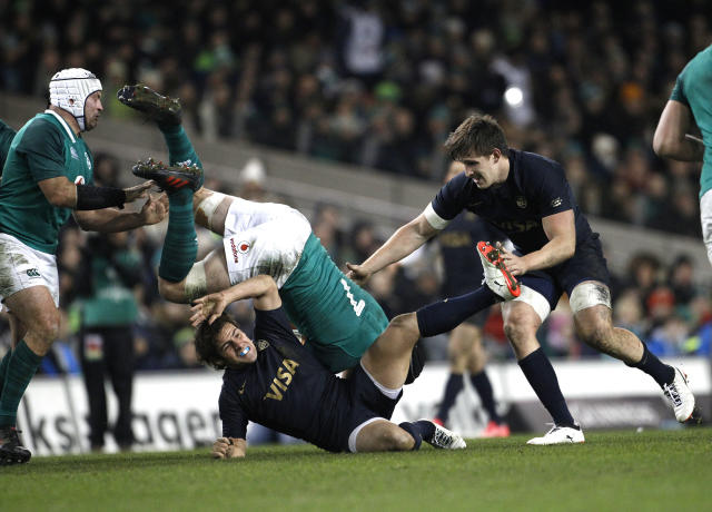 Ireland's Sean O'Brien, centre, is tackled by Argentina's Nicolas Sanchez during a rugby union international match at the Aviva stadium in Dublin, Ireland, Saturday, Nov. 25, 2017. (AP Photo/Peter Morrison)