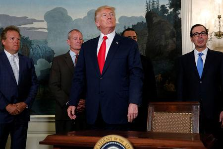 U.S. President Donald Trump responds to a reporter's question after signing a memorandum directing the U.S. Trade Representative to complete a review of trade issues with China at the White House in Washington, U.S. August 14, 2017.  REUTERS/Jonathan Ernst