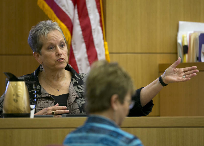 Alyce LaViolette a domestic violence expert responds to a question from Prosecutor Juan Martinez during cross examination during the Jodi Arias trial. Arias is on trial for the killing of Travis Alexander, in 2008. (AP Photo/The Arizona Republic, David Wallace, Pool )