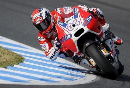 FILE PHOTO - Ducati MotoGP rider Andrea Dovizioso of Italy rides during a free practice session at the Twin Ring Motegi circuit ahead of Sunday's Japanese Grand Prix in Motegi,Japan