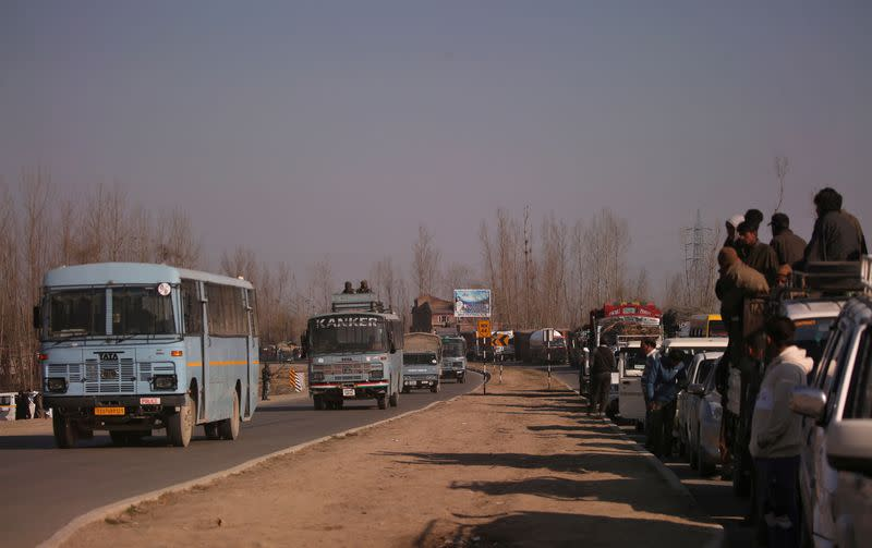 FILE PHOTO: Traffic is stopped as the Indian Central Reserve Police Force (CRPF) convoy moves along a national highway in Qazigund