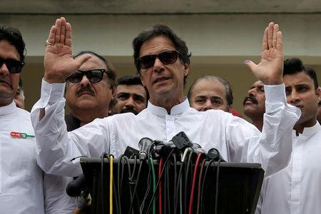 FILE PHOTO: Cricket star-turned-politician Imran Khan, chairman of Pakistan Tehreek-e-Insaf (PTI), speaks after voting in the general election in Islamabad, Pakistan July 25, 2018. REUTERS/Athit Perawongmetha/File Photo
