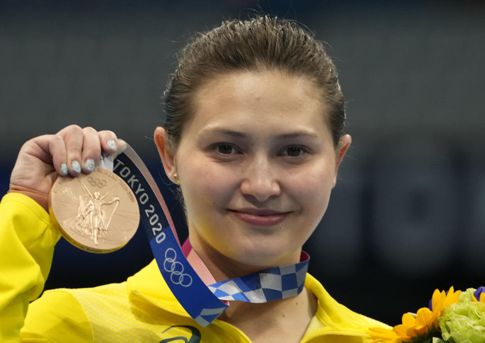 Melissa Wu of Australia poses for a photo after winning bronze medal in women's diving 10m platform final at the Tokyo Aquatics Centre at the 2020 Summer Olympics, Thursday, Aug. 5, 2021, in Tokyo, Japan. (AP Photo/Dmitri Lovetsky)