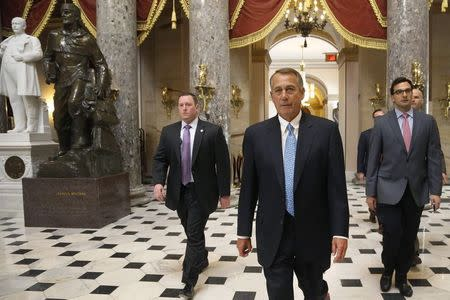 U.S. House Speaker John Boehner (R-OH) (2nd R) returns to his office after a visit to the House floor for procedural votes for legislation to fund the Department of Homeland Security at the Capitol in Washington, February 27, 2015. REUTERS/Jonathan Ernst