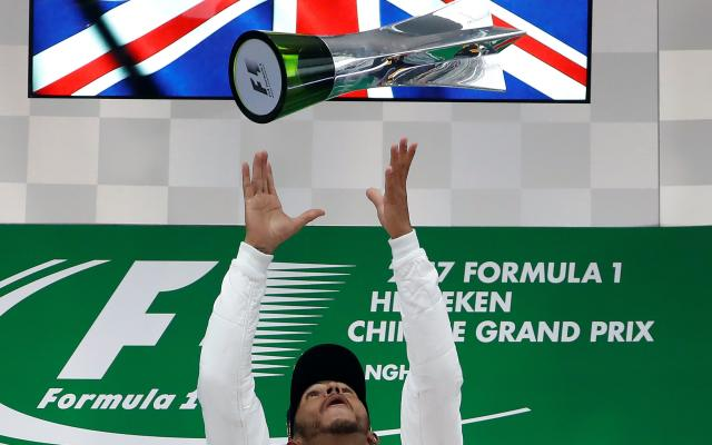 <span>Lewis Hamilton celebrates winning the second race of the season, the Chinese GP</span> <span>Credit: REUTERS </span>