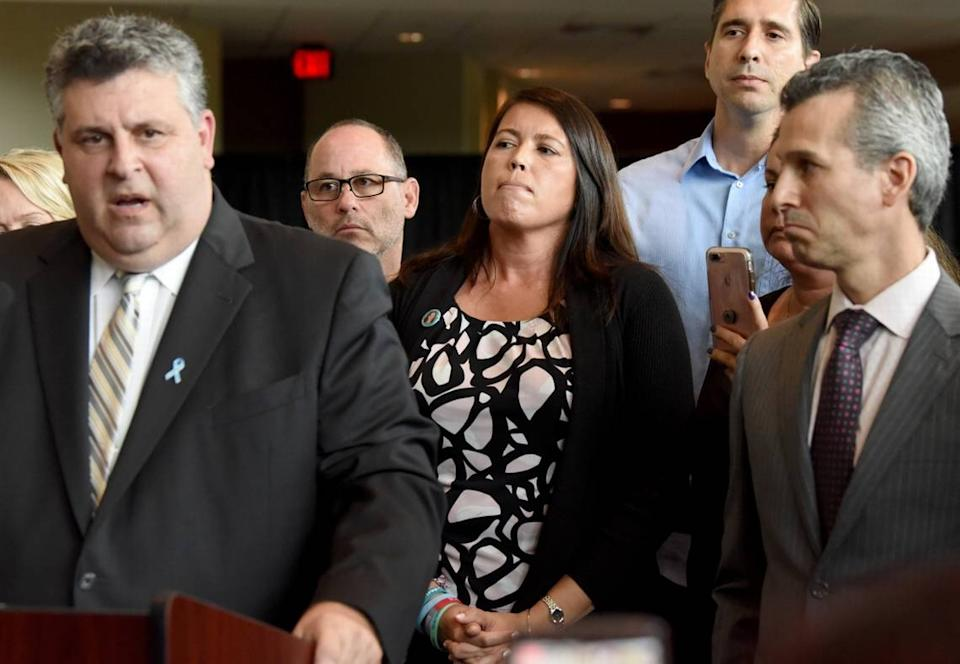Tony Montalto, left, speaks during a press conference in August with other family members of Parkland shooting victims, including Fred Guttenberg, April Schentrup, and Max Schachter, in Sunrise.