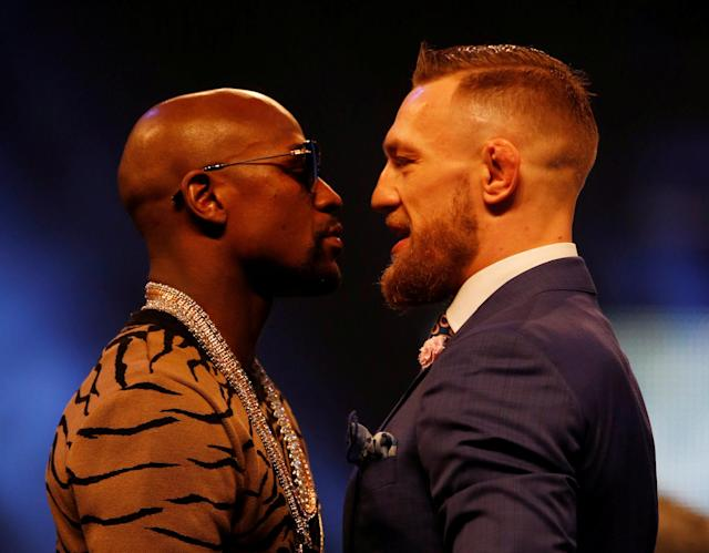 Floyd Mayweather Jr. (L) and Conor McGregor face off during a news conference on July 14. (AP)