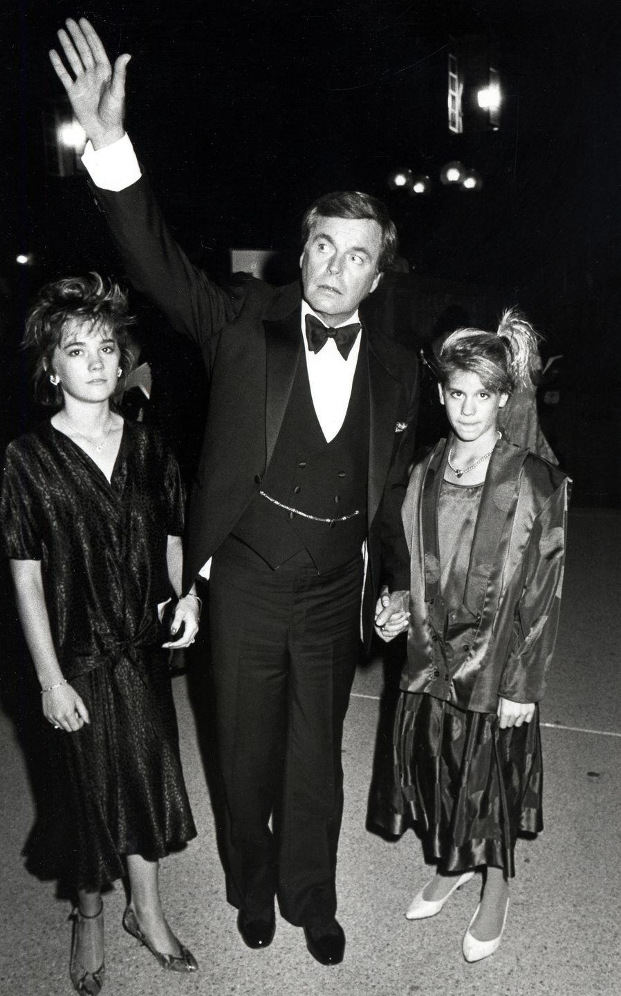 <p>After the tragic death of his wife, Natalie Wood, Robert Wagner raised their daughter Natasha Wagner (left). Here, the actor attends the 37th Emmy Awards with Natasha and her friend. </p>