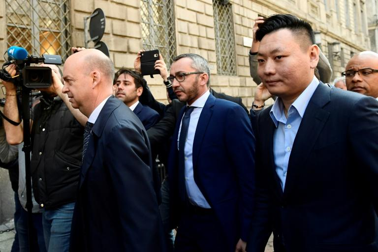 Han Li (R) and Marco Fassone (L), representatives of Chinese consortium Sino-Europe Sports (SES), arrive in Milan to finalize the deal with Fininvest for AC Milan's takeover by Rossoneri Sport Investment Lux on April 13, 201