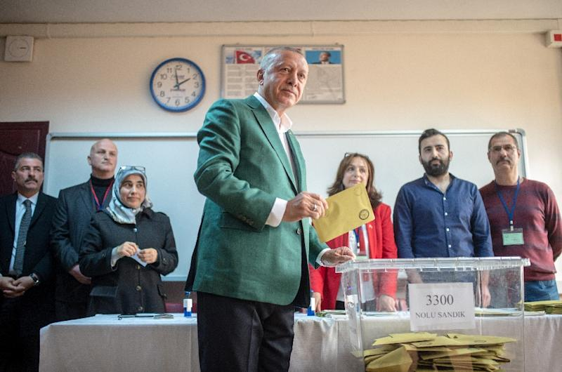 Turkish President Tayyip Erdogan (C) Erdogan had campaigned hard in Istanbul, presenting the vote as a matter of national survival (AFP Photo/BULENT KILIC)