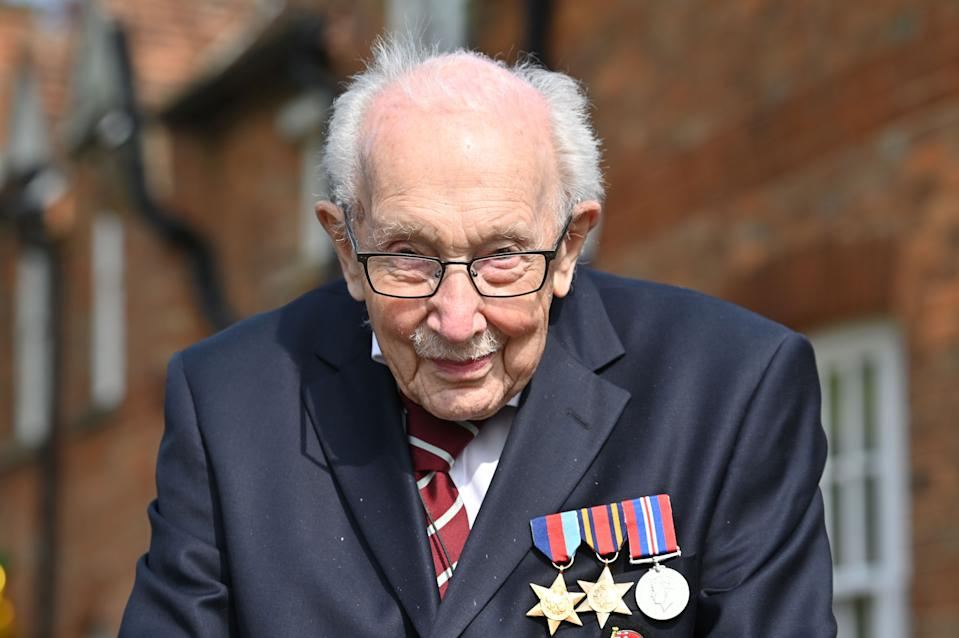 "British World War II veteran Captain Tom Moore, 99, poses doing a lap of his garden in the village of Marston Moretaine, 50 miles north of London, on April 16, 2020. - A 99-year-old British World War II veteran Captain Tom Moore on April 16 completed 100 laps of his garden in a fundraising challenge for healthcare staff that has ""captured the heart of the nation"", raising more than £13 million ($16.2 million, 14.9 million euros). ""Incredible and now words fail me,"" Captain Moore said, after finishing the laps of his 25-metre (82-foot) garden with his walking frame. (Photo by JUSTIN TALLIS / AFP) (Photo by JUSTIN TALLIS/AFP via Getty Images)"