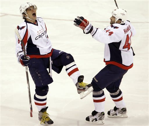 Washington Capitals' Alex Ovechkin, left, of Russia, celebrates his goal against the Columbus Blue Jackets with teammate Roman Hamrlik, of the Czech Republic, during the third period of an NHL hockey game, Saturday, Dec. 31, 2011, in Columbus, Ohio. The Capitals won 4-2. (AP Photo/Jay LaPrete)