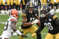 Pittsburgh Steelers wide receiver Chase Claypool (11) runs past Cleveland Browns cornerback Terrance Mitchell (39) to follow blocking by running back Jaylen Samuels (38) as he runs for a touchdown during the second half of an NFL football game, Sunday, Oct. 18, 2020, in Pittsburgh. (AP Photo/Don Wright)