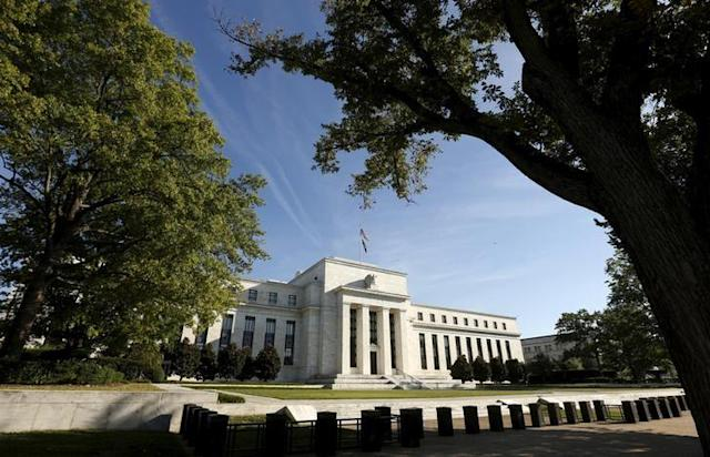 Investors say the Federal Reserve's expectation for three rate hikes is too low. PHOTO: The Federal Reserve building in Washington