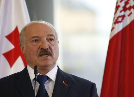 FILE PHOTO - Belarussian President Alexander Lukashenko speaks during a joint news conference with his Georgian counterpart Georgy Margvelashvili following their meeting in Tbilisi