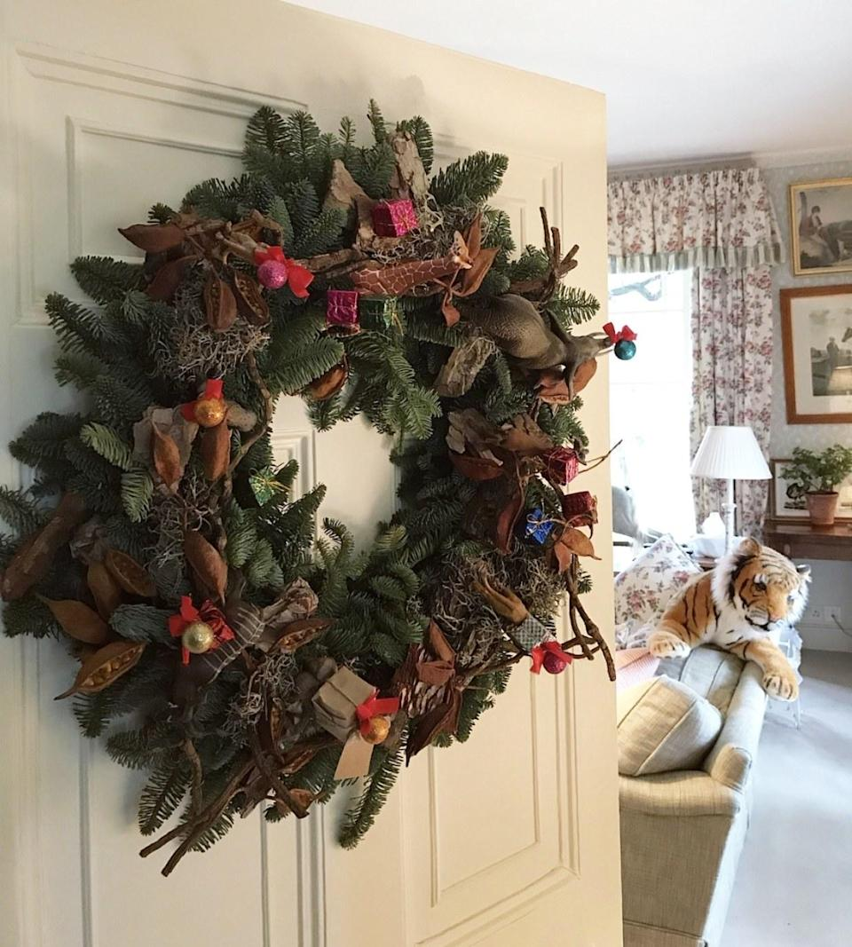 How divine is this wreath made for us by our pal, Caroline Rupert? With the kids in mind, she decorated it with African animal figures the kids can keep after the holidays.