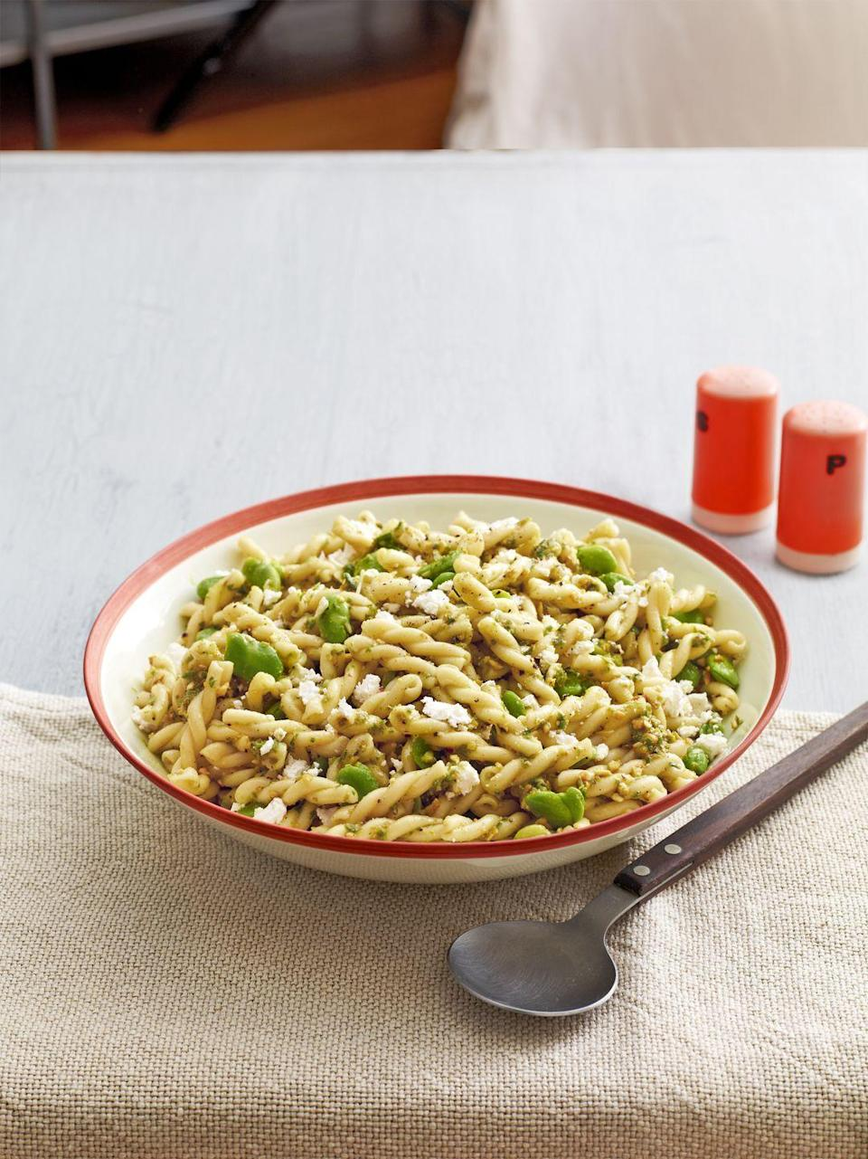 """<p>Lighten up! Reduce Parmesan, pistachios, and olive oil each to 1/3 cup, add 1/4 cup water, and substitute in low-fat feta. Total savings? 110 calories and 12 fat grams per serving.</p><p><strong><a href=""""https://www.countryliving.com/food-drinks/recipes/a5137/fava-bean-pasta-salad-garlic-scape-pesto-recipe-clx0514/"""" rel=""""nofollow noopener"""" target=""""_blank"""" data-ylk=""""slk:Get the recipe."""" class=""""link rapid-noclick-resp"""">Get the recipe.</a></strong></p>"""