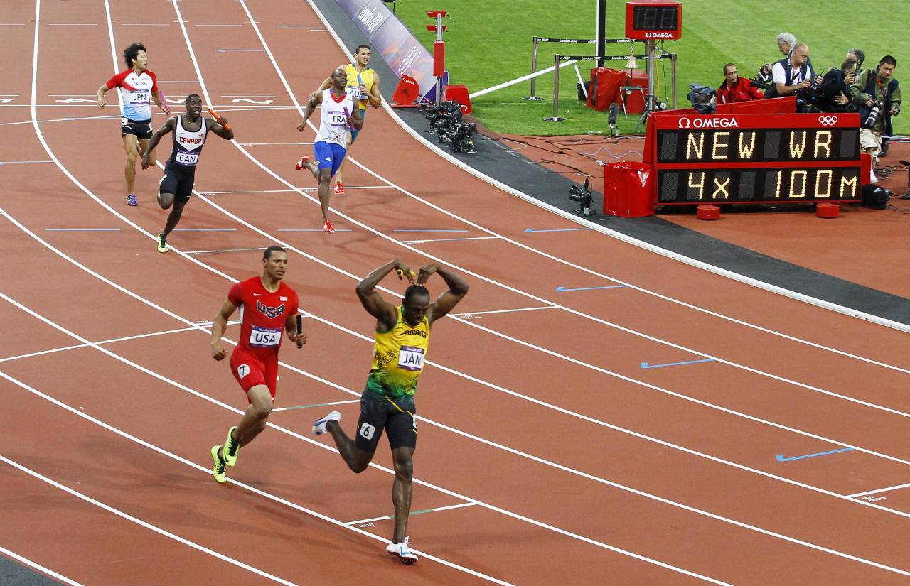 Jamaica's Usain Bolt celebrates after he won gold ahead of Ryan Bailey of the U.S. in the men's 4x100m relay final at the London 2012 Olympic Games at the Olympic Stadium August 11, 2012. The Jamaican team set a new world record of 36.84 seconds. REUTERS/David Gray (BRITAIN  - Tags: OLYMPICS SPORT ATHLETICS)