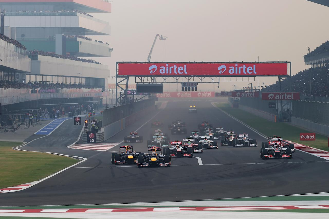 NOIDA, INDIA - OCTOBER 28:  Sebastian Vettel of Germany and Red Bull Racing leads the field into the first corner at the start of the Indian Formula One Grand Prix at Buddh International Circuit on October 28, 2012 in Noida, India.  (Photo by Mark Thompson/Getty Images)