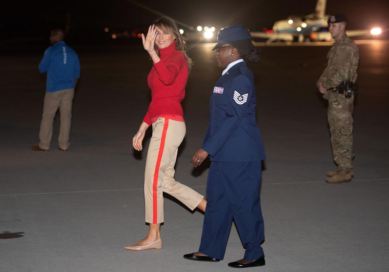 <p>The First Lady wore striped khaki pants and a red turtleneck sweater while landing at Joint Base Andrews in Maryland upon her return from Africa.</p>