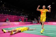 LONDON, ENGLAND - AUGUST 03: Nan Zhang (L) and Yunlei Zhao of China celebrate winning the Mixed Doubles Badminton Gold Medal match against compatriots Chen Xu and Jin Ma of China on Day 7 of the London 2012 Olympic Games at Wembley Arena on August 3, 2012 in London, England. (Photo by Michael Regan/Getty Images)