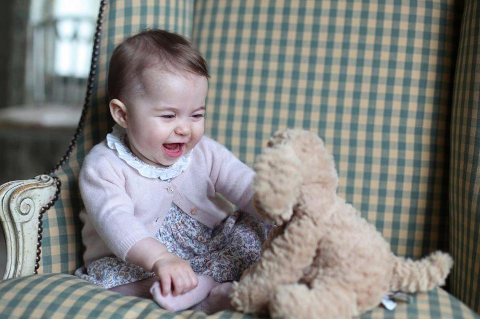 <p>Princess Charlotte plays with a stuffed toy at Anmer Hall in November 2015. The adorable candid was taken by Kate Middleton in Sandringham, England.</p>