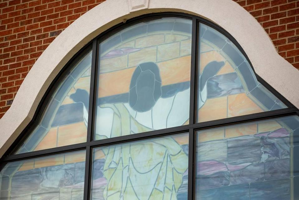 A stained glass window depicting Jesus lets light into the sanctuary of Oak City Baptist Church which was established the Oak Grove Cemetery, in the early 1870s in what was one of five villages created by freed African-Americans after the Civil War, and now has lost more of its tree buffer to widening of the I-440 Beltline, that separated it from the rest of the Method community in the 1960s, on Tuesday, May 11, 2021, in Raleigh, N.C.