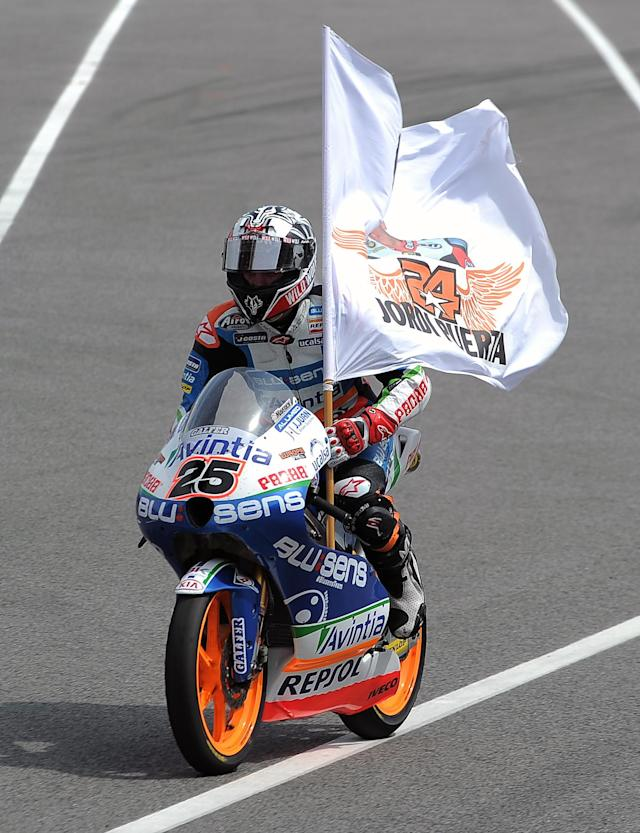 Blusens Avintia's Spanish Maverick Vinales celebrates after winning the Moto3 race of the Catalunya Moto GP Grand Prix at the Catalunya racetrack in Montmelo, near Barcelona, on June 3, 2012. Blusens Avintia's Spanish Maverick Vinales won the race ahead of Red Bull KTM Ajo's German Sandro Cortese and Estrella Galicia's Portuguese Miguel Oliveira. AFP PHOTO / LLUIS GENELLUIS GENE/AFP/GettyImages