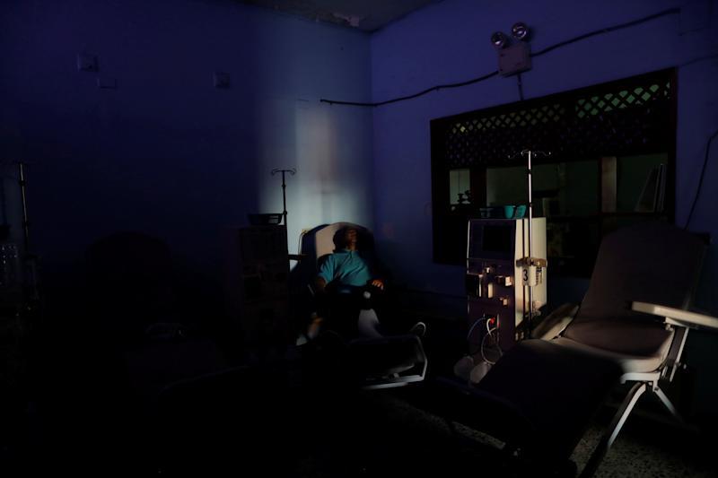 William Lopez, 45, a patient with kidney disease, waits for the electricity to return at a dialysis center during a blackout in Maracaibo, Venezuela. (Photo: Ueslei Marcelino/Reuters)