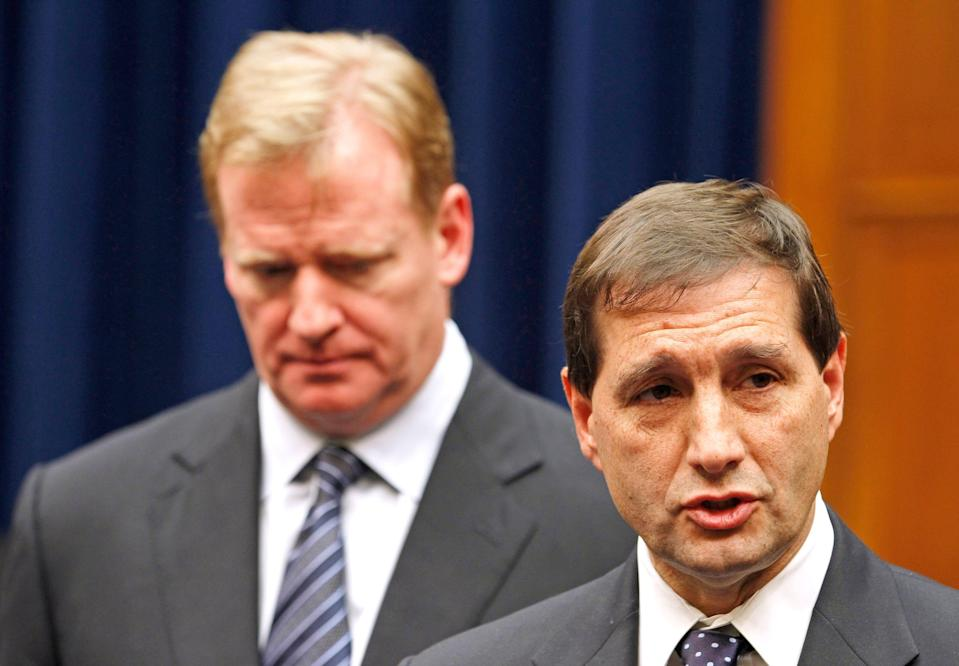 In a 2011 photo, NFL football lead counsel Jeff Pash, right, accompanied by NFL Commissioner Roger Goodell, speaks with reporters.