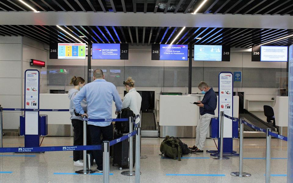 Italian and British passengers at Fiumicino airport, near Rome, Italy, 18 October 2020. United Kingdom imposed a 14-day quarantine provision for people arriving from Italy from 18 October 2020. - TELENEWS/EPA-EFE/Shutterstock