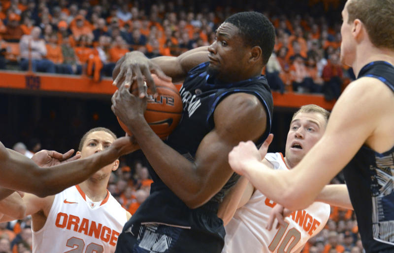 Georgetown's Moses Ayegba grabs a rebound against Syracuse during the first half in an NCAA college basketball game in Syracuse, N.Y., Saturday, Feb. 23, 2013. (AP Photo/Kevin Rivoli)
