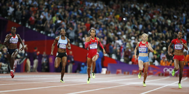 Sanya Richards-Ross (C) of the U.S. runs to win the gold medal in the women's 400m final during the London 2012 Olympic Games at the Olympic Stadium August 5, 2012. From left, the runners are: Britain's Christine Ohuruogu, who won the silver; Botswana's Amantle Montsho, who finished in fourth place; Ross; Russia's Antonina Krivoshapka, who finished in sixth place and DeeDee Trotter of the U.S., who won the bronze. REUTERS/Lucy Nicholson (BRITAIN - Tags: SPORT ATHLETICS OLYMPICS)