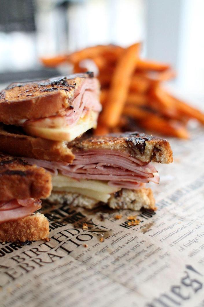 """<p><strong>Vermonter</strong></p><p>Can you guess by the name this sandwich is signature to Vermont? Made with cold cuts, apple slices, and Vermont cheddar, this sweet-and-savory sandwich is found anywhere from Burlington (try <a href=""""https://www.sweetwatersvt.com/"""" rel=""""nofollow noopener"""" target=""""_blank"""" data-ylk=""""slk:Sweetwaters"""" class=""""link rapid-noclick-resp"""">Sweetwaters</a> on Church Street). It's made with sourdough and pressed panini-style. </p>"""