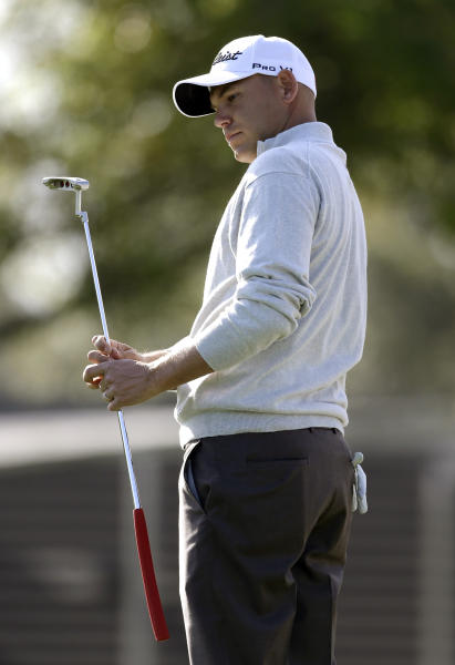 Bill Haas reacts after missing a putt on the 15th green during the second round of the Arnold Palmer Invitational golf tournament, Friday, March 22, 2013, in Orlando, Fla. (AP Photo/John Raoux)