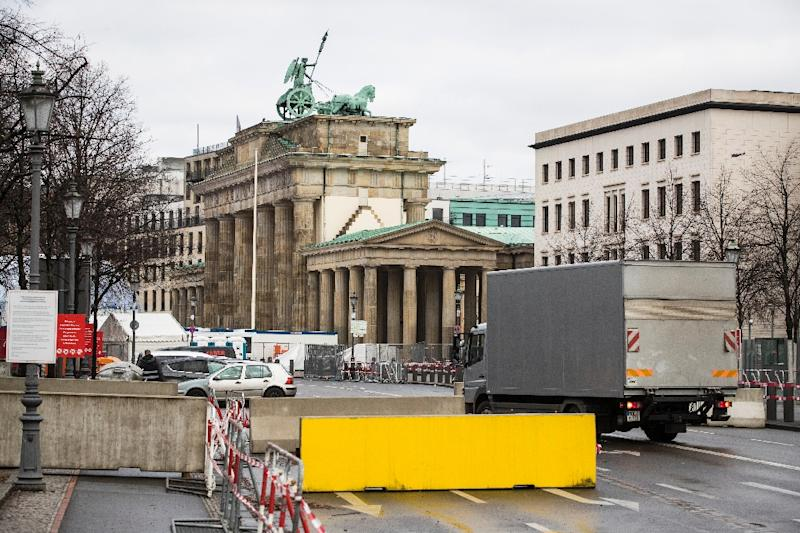 German authorities have stepped up security near the Brandenburg Gate ahead of New Year celebrations in Berlin (AFP Photo/Odd Andersen)