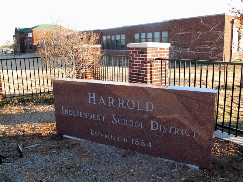 This Monday, Dec. 17, 2012 photo shows the sign in front of the Harrold Independent School District in Harrold, Texas. The K-12 school has a policy allowing teachers and other school employees to carry concealed weapons, a controversial policy that's now being considered in at least five other states in the wake of last week's deadly elementary school shooting in Newtown, Conn. (AP Photo/Angela K. Brown)