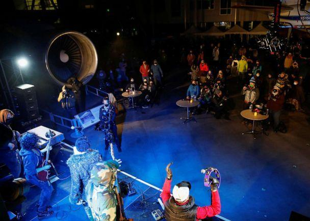 PHOTO: The Black Tones and Payge Turner perform at a socially distanced 'Cleared for Takeoff Concert' produced by organization Safe & Sound Seattle, at the Museum of Flight's Aviation Pavilion in Seattle, March 28, 2021. (Lindsey Wasson/Reuters)