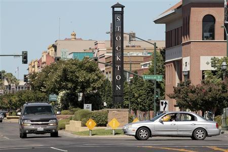 Traffic moves through downtown in Stockton, California which will become the largest U.S. city to file for bankruptcy.