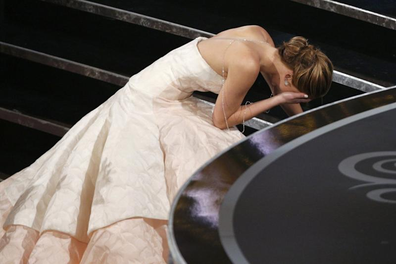 Oops: Lawrence took a tumble while traversing the stairs (Reuters)