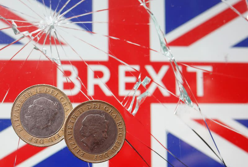 FILE PHOTO: A pound coins are placed on broken glass and British flag in this illustration picture taken