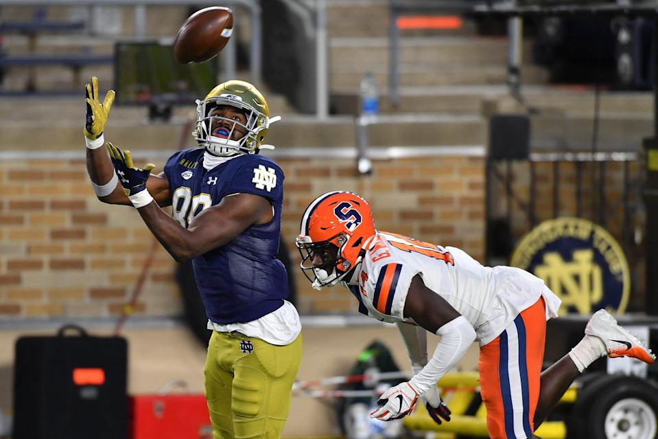 Notre Dame wide receiver Javon McKinley catches a pass for a touchdown in front of Syracuse cornerback Garett Williams during his game at Notre Dame Stadium.