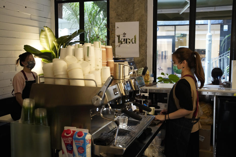 Employees work at the Found Cafe in Hong Kong on Sept. 13, 2020. Cannabis, also known as marijuana, in Hong Kong may be illegal, but the new Found Cafe is offering a range of food and drinks that contain parts of the cannabis plant without breaking any local laws. (AP Photo/Vincent Yu)