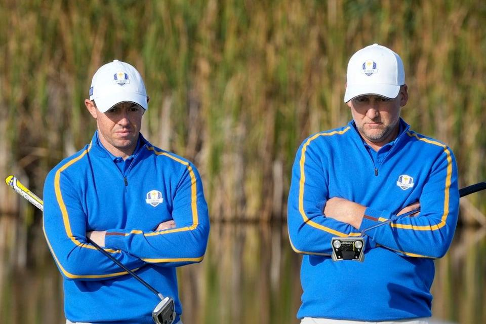 Team Europe's Rory McIlroy and Team Europe's Ian Poulter wait to putt on the fifth hole during a foursome match the Ryder Cup (Charlie Neibergall/AP) (AP)