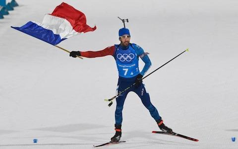<span>Martin Fourcade won his third gold of these Games on Tuesday</span> <span>Credit: Getty Images </span>