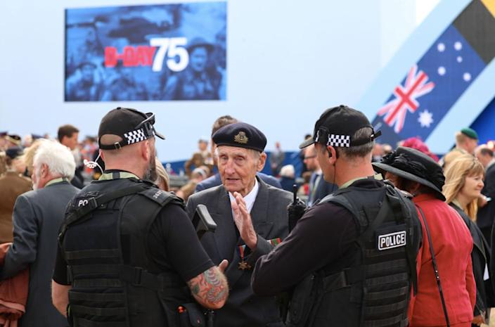 The D-Day veteran was pictured speaking to armed police officers during the commemorations in Portsmouth (PA)