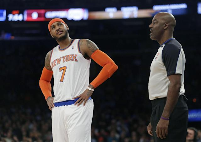 New York Knicks' Carmelo Anthony (7) argues a call with referee Haywoode Workman during the first half of an NBA basketball game, Friday, Jan. 17, 2014, in New York. (AP Photo/Frank Franklin II)